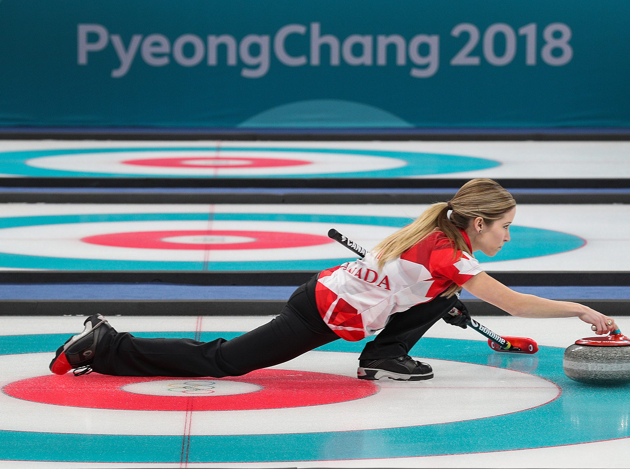 Feb 13, 2018; Gangneung, South Korea; Team Canada's Kaitlyn Lawes and John Morris won the gold medal in mixed doubles by defeating Team Switzerland's Jenny Perret and Martin Rios during the Pyeongchang 2018 Olympic Winter Games at Gangneung Curling Centre. Mandatory Credit: Matt Kryger-USA TODAY Sports