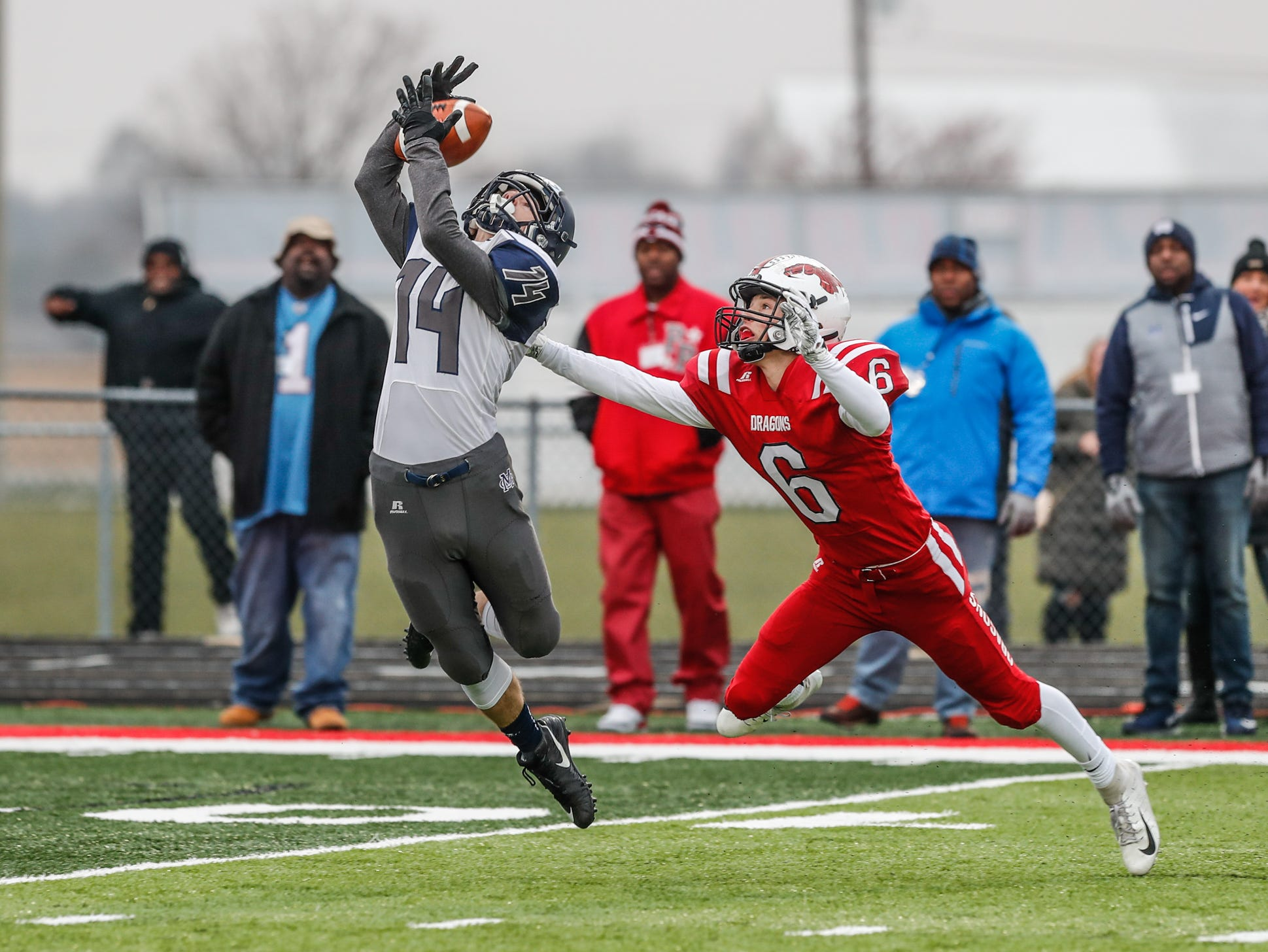 Michigan City High School's wide receiver Zennon Wilhelm (14), gets around New Palestine High School's Brody Luker (6), to make an amazing catch during the I.H.S.A.A class 5A Semi-state game between New Palestine High School and Michigan City High School on Saturday, Nov. 17, 2018.