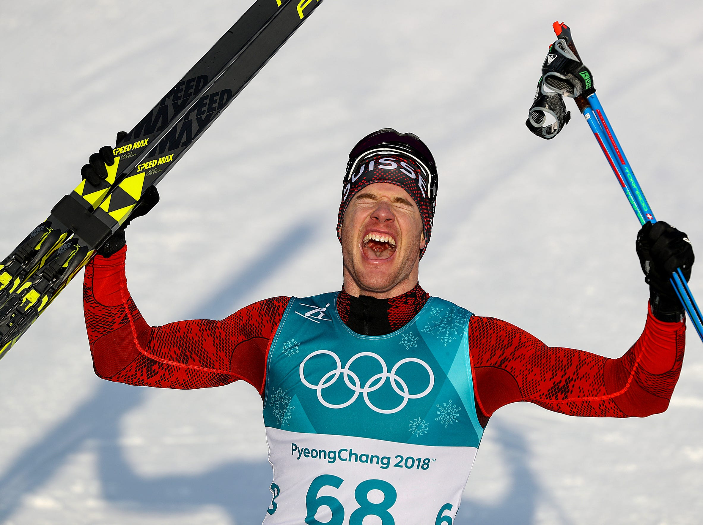 Feb 16, 2018; Pyeongchang, South Korea; Switzerland's Dario Cologna celebrates his gold medal win following the Men's 15k free Cross Country finals during the Pyeongchang 2018 Olympic Winter Games at Alpensia Cross-Country Centre. Mandatory Credit: Matt Kryger-USA TODAY Sports