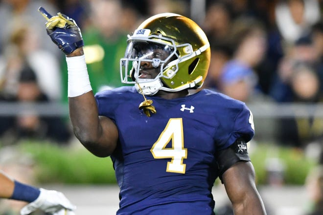 Fighting Irish linebacker Te'von Coney (4) celebrates after a tackle in the second quarter against the Stanford Cardinal at Notre Dame Stadium.