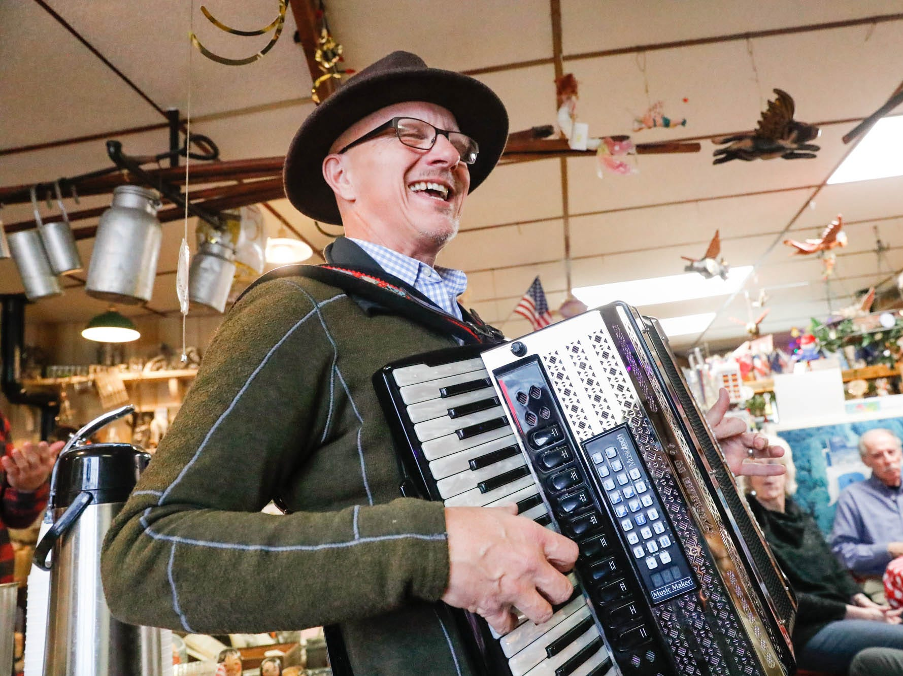 Norman Gwaltney plays the accordion during a party celebrating the 50th year in business at Heidelberg Haus Cafe and Bakery, 7625 Pendleton Pike, Indianapolis, on Saturday, Dec. 8th, 2018. The cafe, bakery, and German grocery is well known for its extensive collection of German Kitsch.