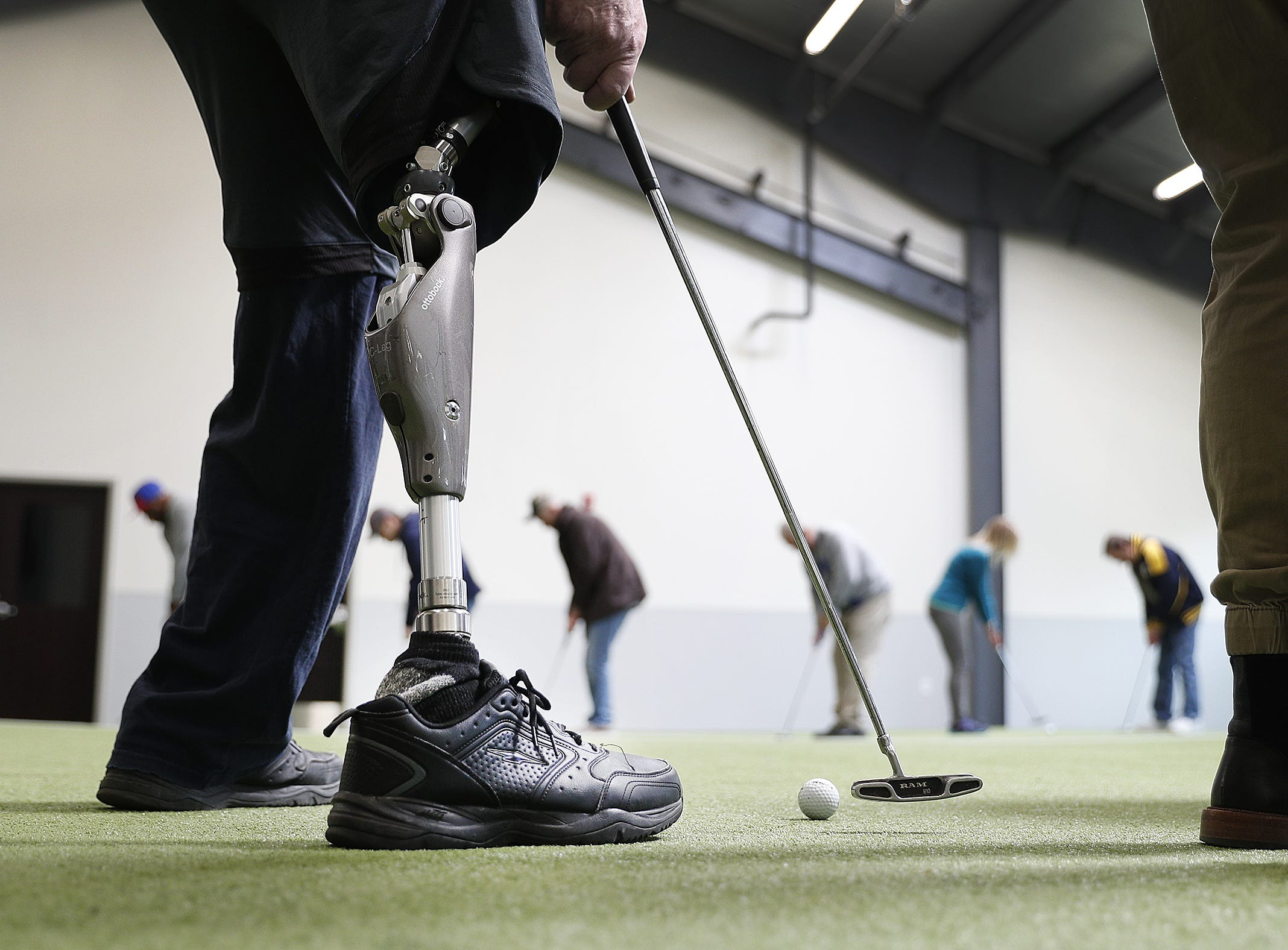 Veterans work on their putting speeds on the putting green at the PGA Hope program at the Highland Golf and Country Club Wednesday April 18, 2018. The PGA Hope program helps veterans get back into the swing of golfing with the help from many local golf professionals and courses.