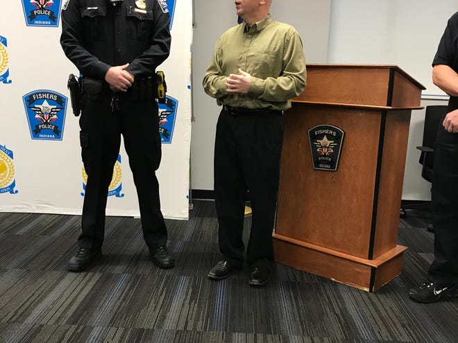 Fishers Police Officer Corey Miller stands alongside Troy Borgens, who he saved from Sudden Cardiac Arrest Nov. 11, 2018.