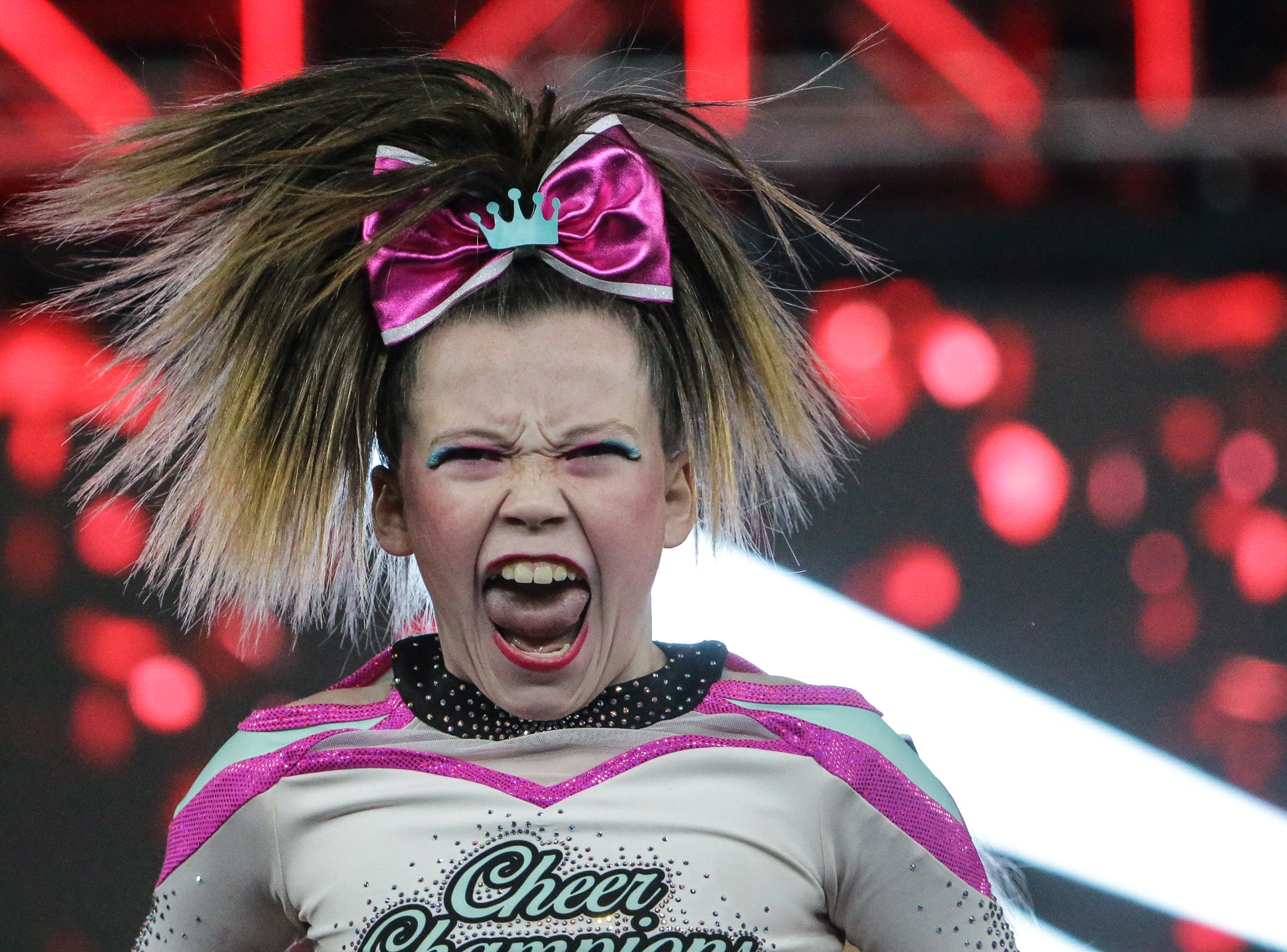 A member of Tiffany's Cheer and Dance Studio Lady Diamonds gives her best spirit face during the JAMfest Cheer Super Nationals held at the Indiana Convention Center on Sunday, Jan. 28, 2018.