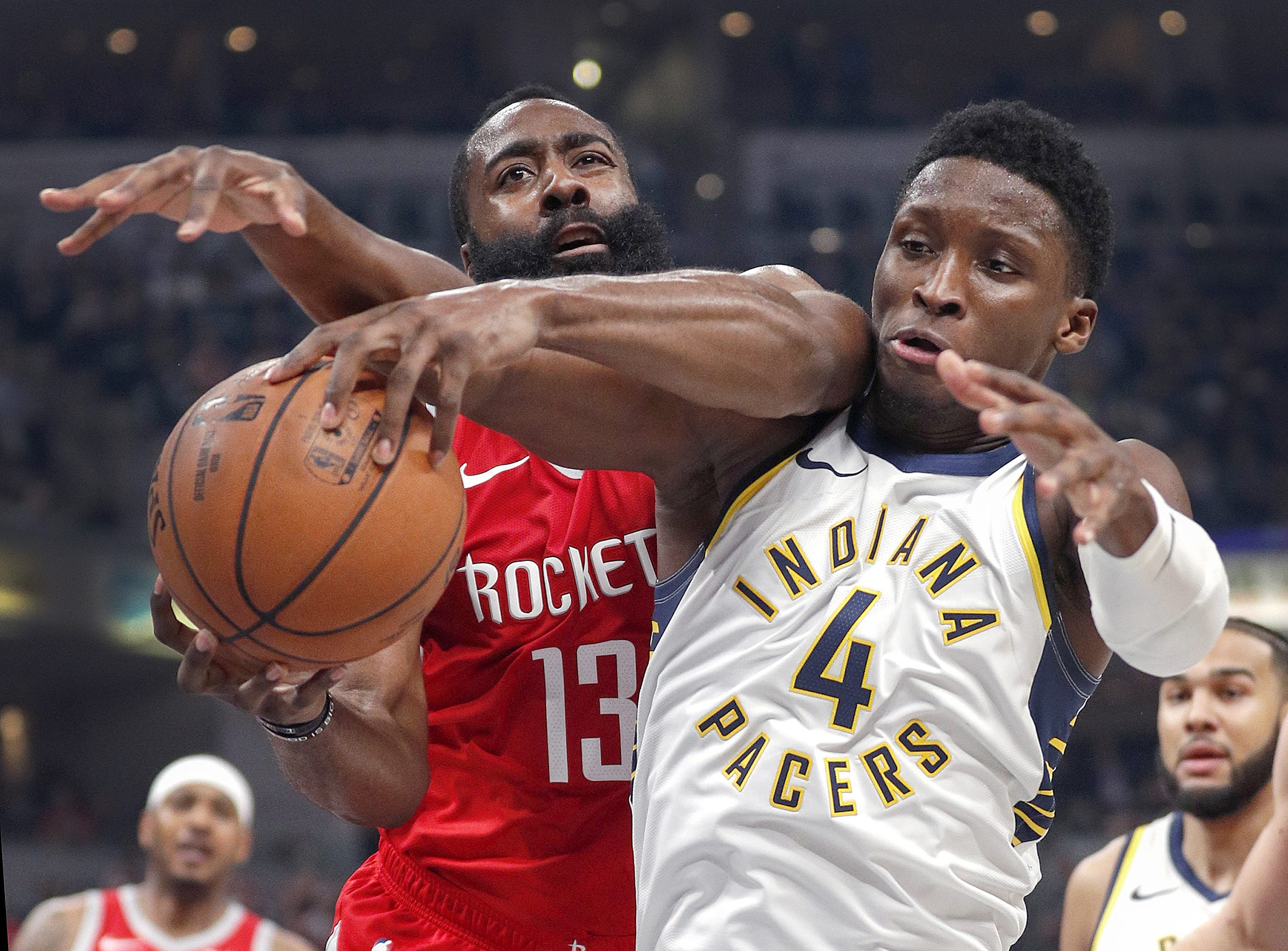 Indiana Pacers guard Victor Oladipo (4) and Houston Rockets guard James Harden (13) fight for a rebound in the first half of their game at Bankers Life Fieldhouse on Nov. 5, 2018.