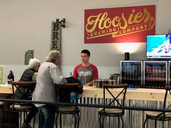 Hoosier Brewing Company owner Mike Rincker talks to customers in his pop-up beer garden on the third floor of Circle Centre Mall.
