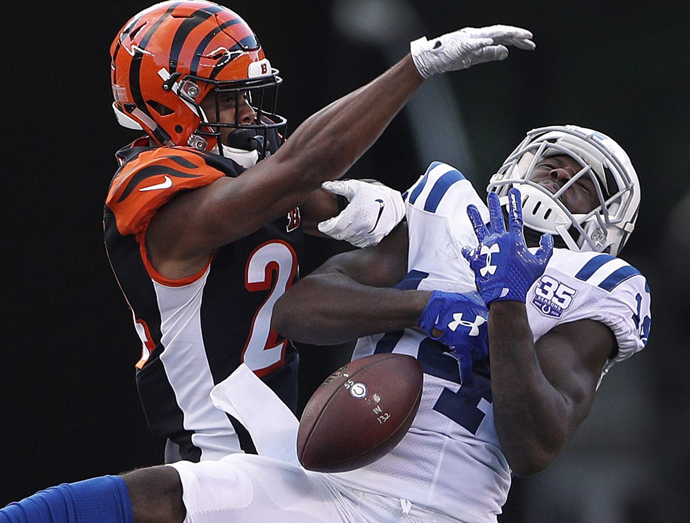 Cincinnati Bengals defensive back C.J. Goodwin (24) knocks the ball away from Indianapolis Colts wide receiver Zach Pascal (14) in the first half of their preseason football game at Paul Brown Stadium in Cincinnati, OH. on Thursday, Aug. 30, 2018.
