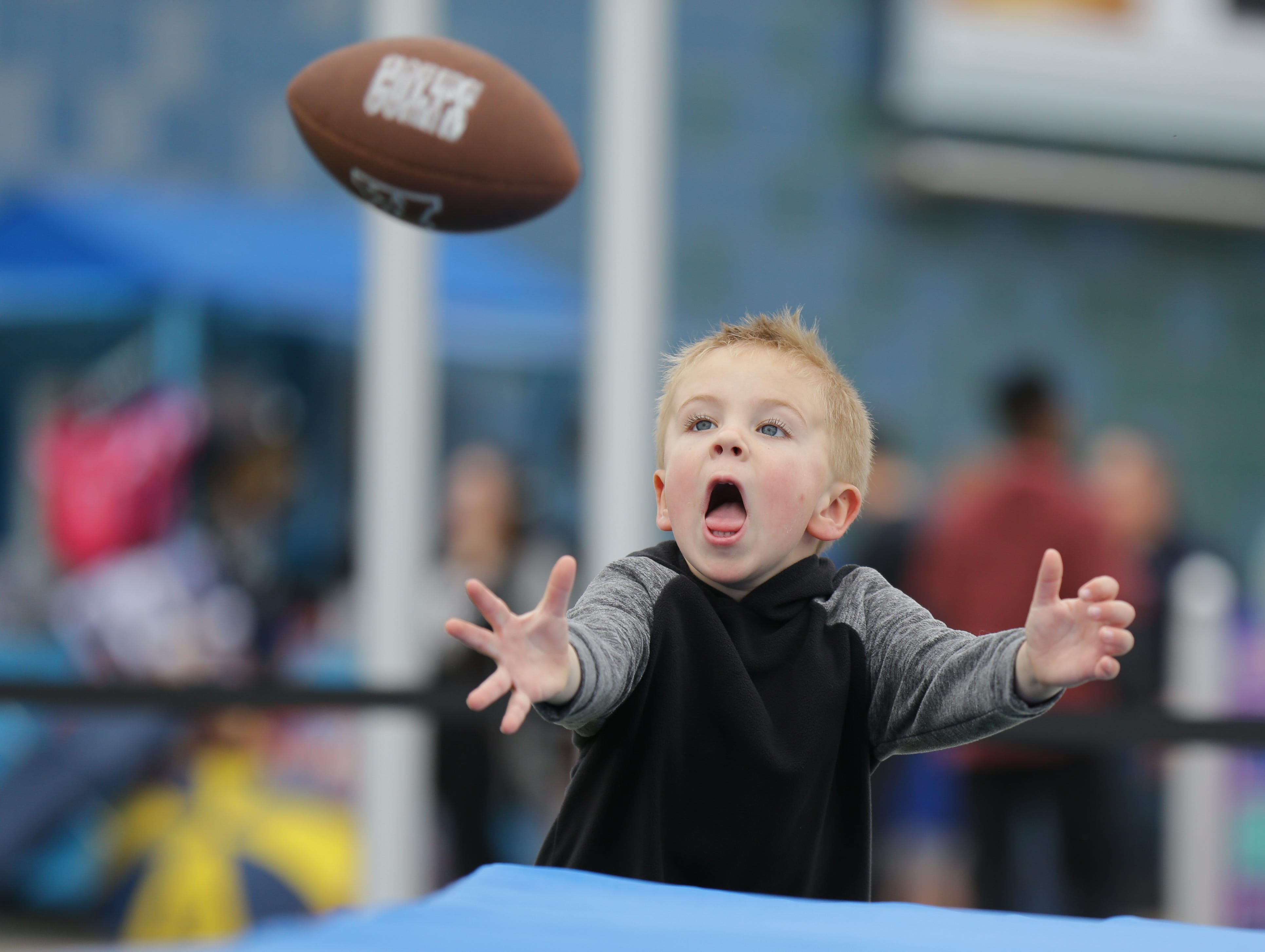Jack Farr races to make a catch during a visit to the Riley Children's Health Sports Legends Experience at the Children's Museum of Indianapolis on Wednesday, March 28, 2018.