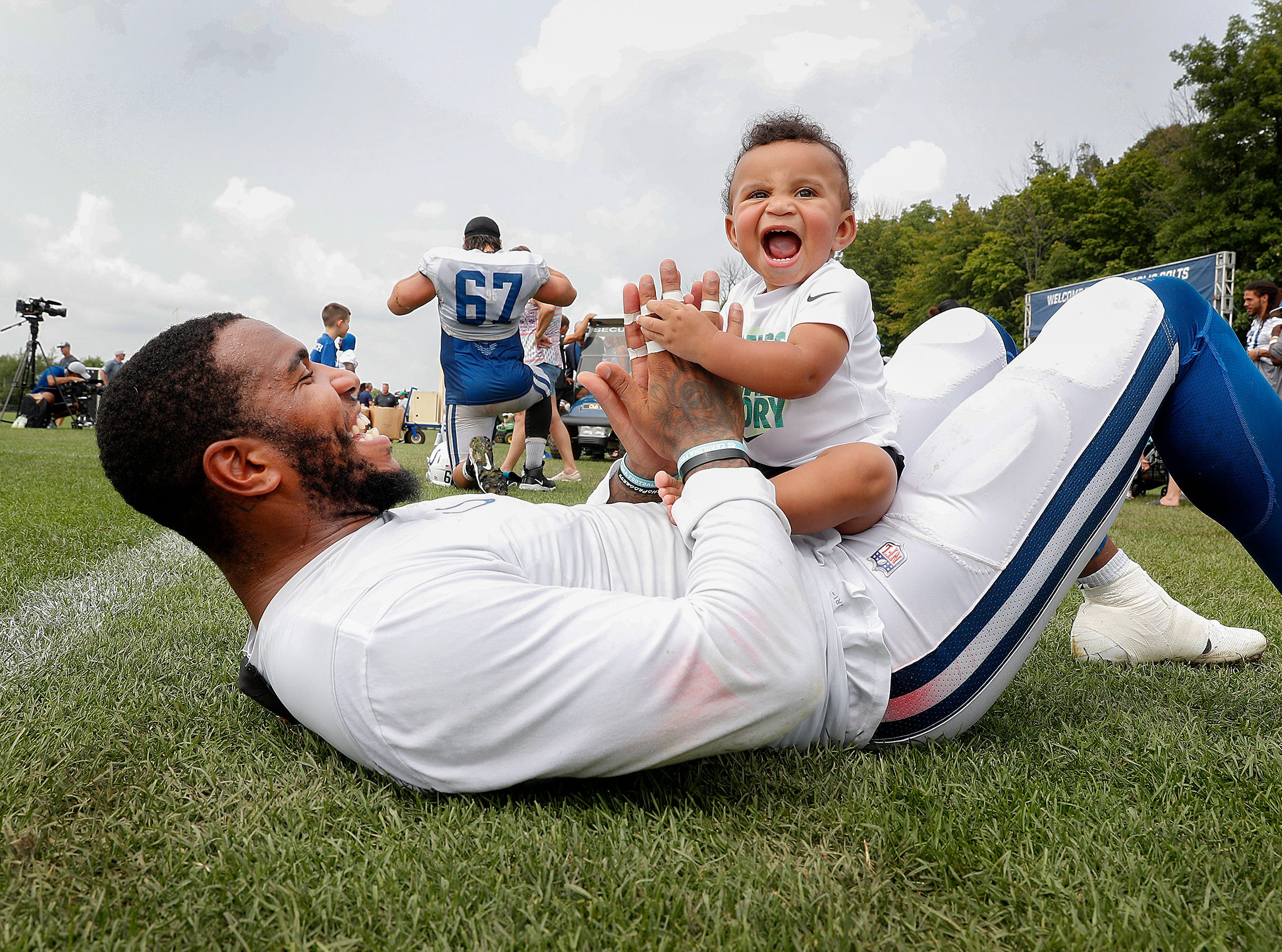 Indianapolis Colts tight end Eric Ebron (85) plays with his son Oliver following the Colts and Ravens joint practice at Grand Park in Westfield on Saturday Aug 18.