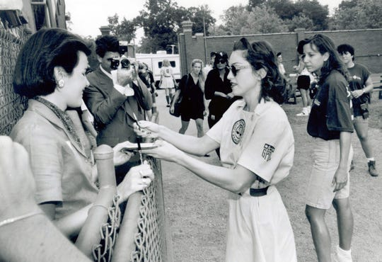 Madonna, right, signs autographs at Evansville's Bosse Field on Sept. 9, 1991.