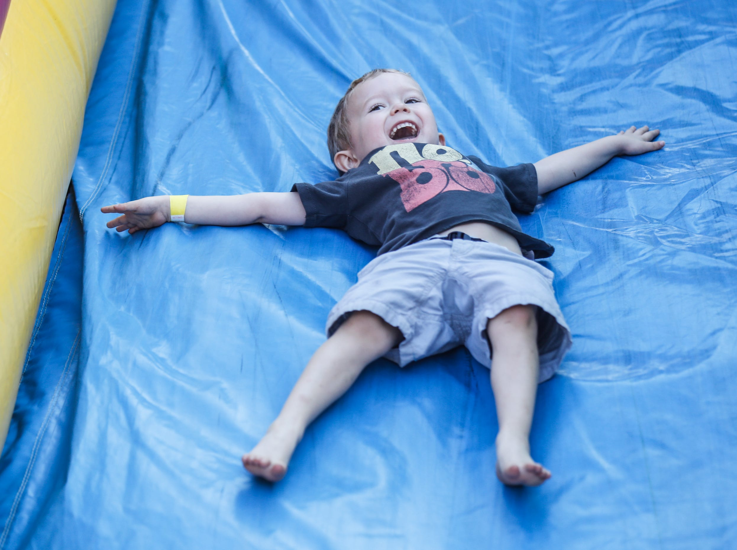 Maddox Roller takes a trip down a slide during the annual St. Vincent and Peyton Manning ChildrenÕs Hospital NICU Reunion at Lions Park in Zionsville Ind. on Sat. Aug. 18, 2018.