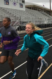 Craig Jordan, then Greencastle track coach, is continuing to train Emma Wilson.  Wilson is not running for Greencastle this season because, she says, of how the school has treated her coach.
