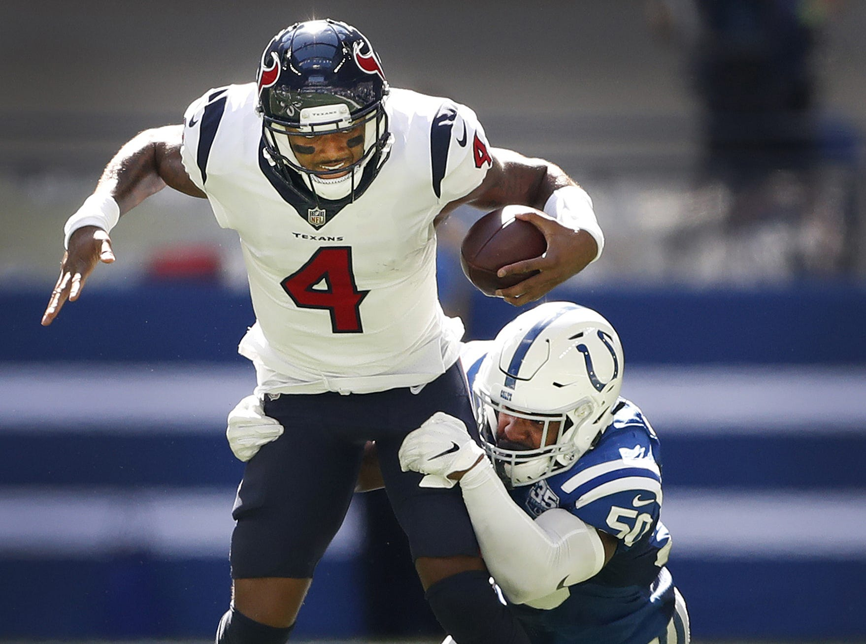 Indianapolis Colts linebacker Anthony Walker (50) sacks Houston Texans quarterback Deshaun Watson (4) in the first half of their game on Sunday, Sept. 30, 2018.