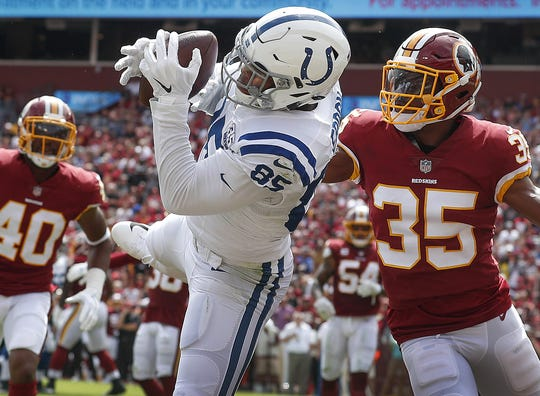 Indianapolis Colts tight end Eric Ebron (85) pulls in an Andrew Luck pass for a touchdown in the first half of their game at FedEx Field in Landover MD. on Sunday, Sept. 16, 2018.