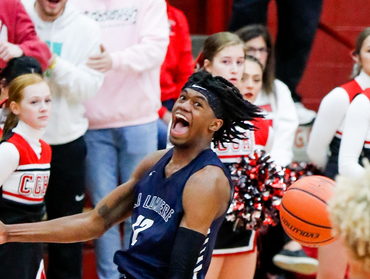 La Lumiere School's Keion Brooks (12) celebrates a dunk during a Tip Off Classic game between Center Grove High School and La Lumiere School, held at the Southport Fieldhouse, on Saturday, Dec. 8, 2018.