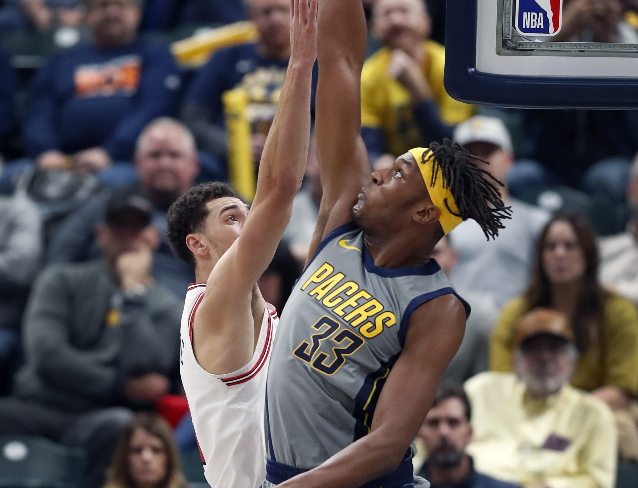 Indiana Pacers center Myles Turner (33) blocks the shot by Chicago Bulls guard Zach LaVine (8) in the first half of their game at Bankers Life Fieldhouse on Tuesday, Dec. 4, 2018.