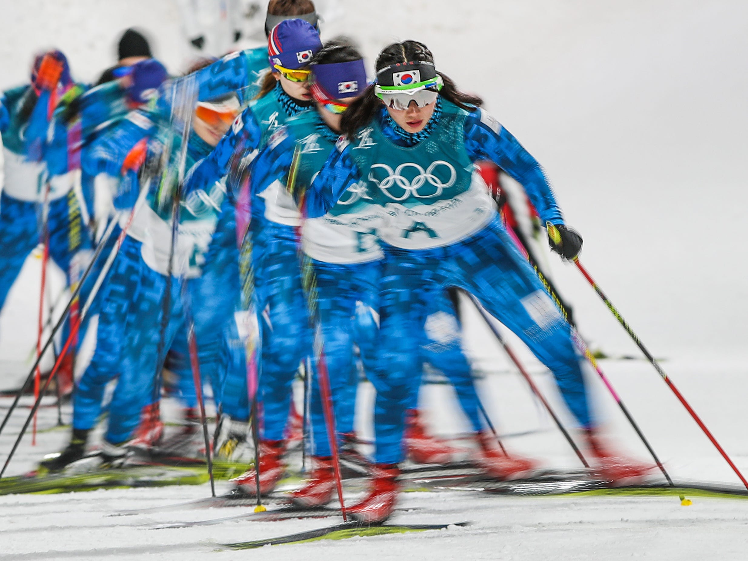 Feb 10, 2018; Pyeongchang, South Korea; A group of forerunners run the course before the start of the Women's 7.5km Sprint during the Pyeongchang 2018 Olympic Winter Games at Alpensia Biathlon Centre. Mandatory Credit: Matt Kryger-USA TODAY Sports