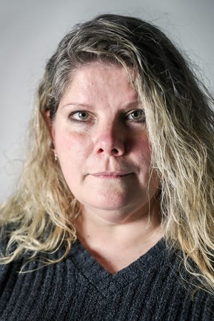 Kristine Bunch poses for a portrait in the IndyStar studio, Tuesday, Dec. 11, 2018. Bunch was wrongfully convicted in 1996 of murder and arson for allegedly starting a fire that killed her 3-year-old son. She served 17 years in prison before it was revealed evidence used to convict her had been fabricated. She was exonerated and released in 2012 but has struggled to rebuild her life with no help from from the state that sent her to prison.