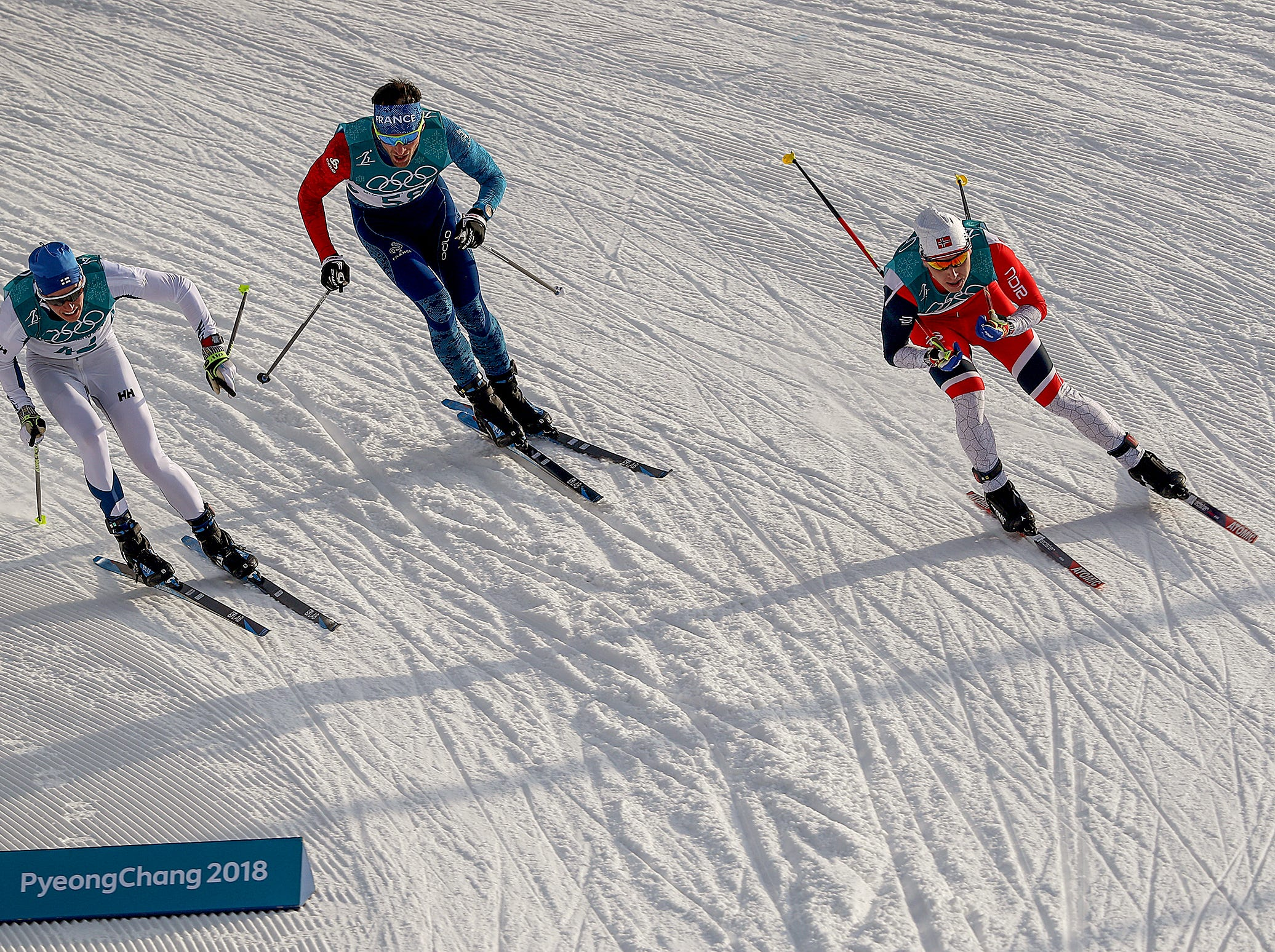 Feb 16, 2018; Pyeongchang, South Korea; Finland's Matti Heikkinen, left,  Sweden's Daniel Rickardsson,middle, and Norway's Simen Hegstad Krueger,right, round a turn at the Men's 15k free Cross Country finals during the Pyeongchang 2018 Olympic Winter Games at Alpensia Cross-Country Centre. Mandatory Credit: Matt Kryger-USA TODAY Sports