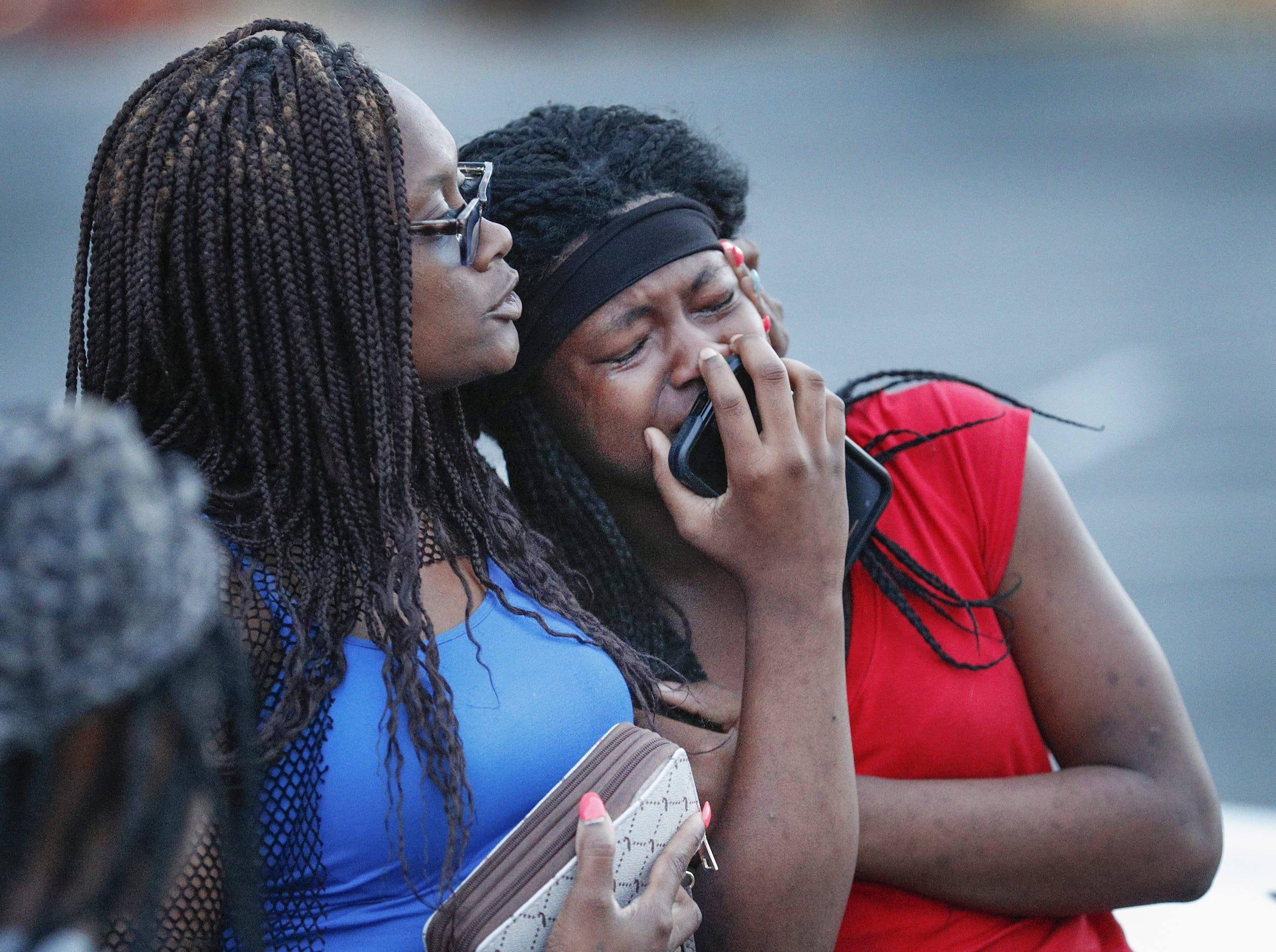 Shanita Yates, left, and comforts Sharaya Yates at the vigil for Trevon Bonds on Wednesday, June 27, 2018. The recent Lawrence North graduate who played on the football team, and was found shot in a westside apartment.