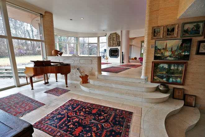 This 1950s modern home at 6474 Meridian St., is seen Friday, Dec. 14, 2018.  High ceilings and an open floor plan with marble flooring and windows that open to the back yard highlight this living area.