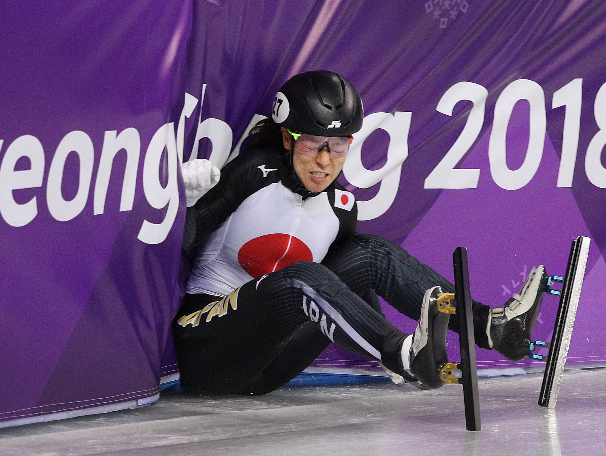 Feb 17, 2018; Pyeongchang, South Korea; Japan's Sumire Kikuchi (JPN) slams into the wall after falling in the Ladies' 1,500m short track speed skating during the Pyeongchang 2018 Olympic Winter Games at Gangneung Ice Arena. Mandatory Credit: Matt Kryger-USA TODAY Sports