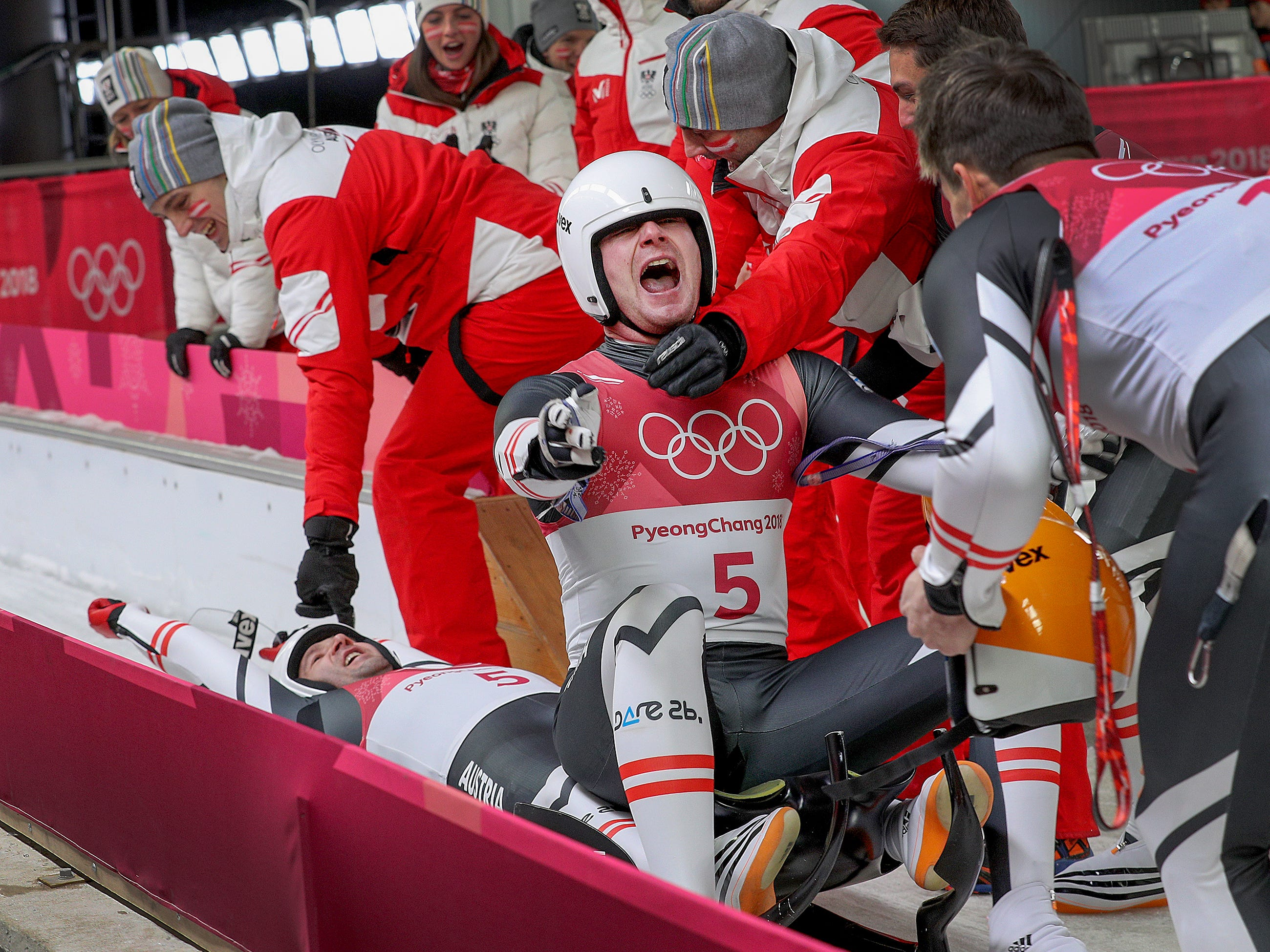 Feb 13, 2018; Gangneung, South Korea; Team Austria's Peter Penz and Georg Fischer celebrate their silver medal runs during Men's Double Luge finals at the Pyeongchang 2018 Olympic Winter Games at Olympic Sliding Centre. Mandatory Credit: Matt Kryger-USA TODAY Sports