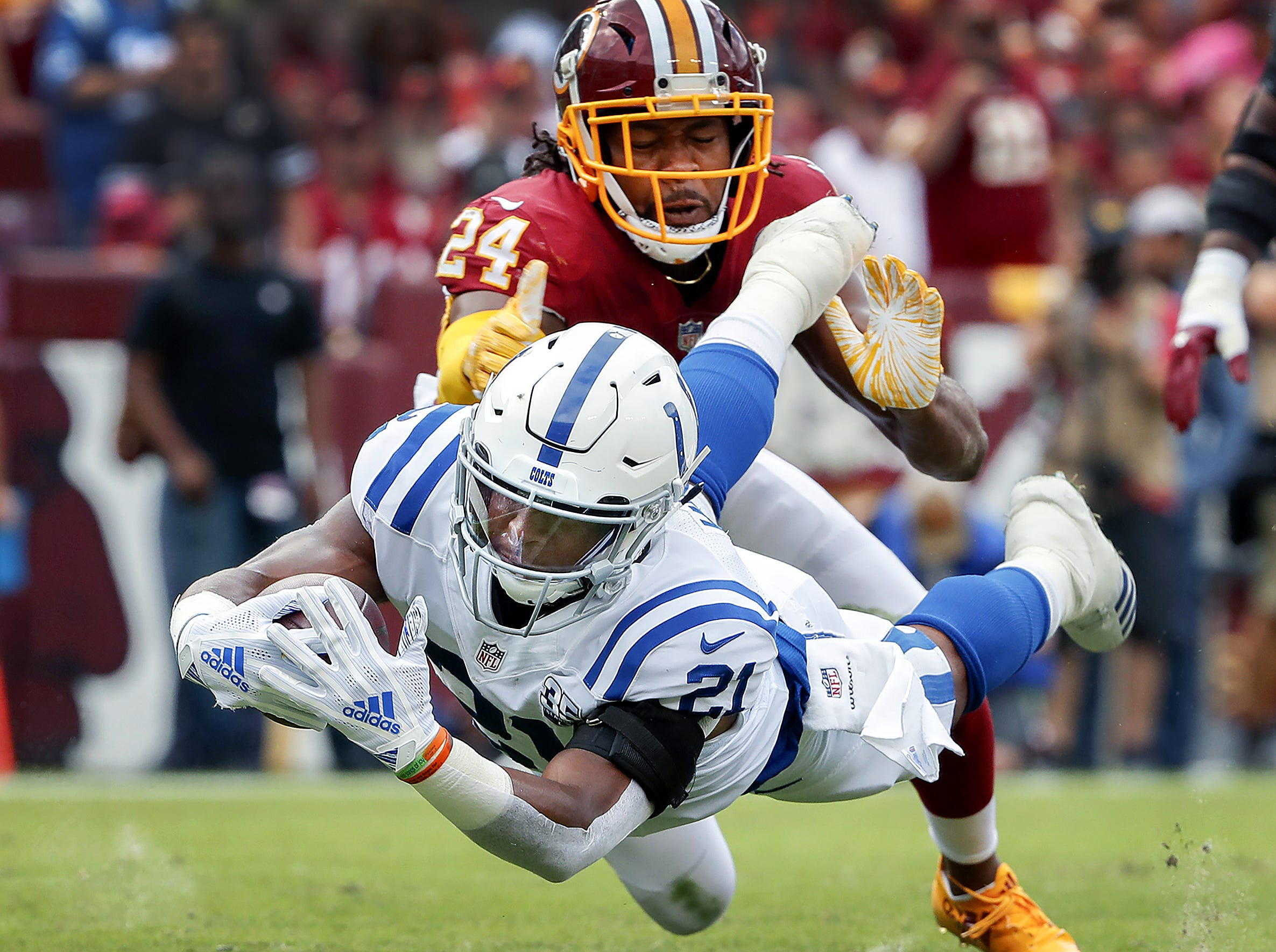 Indianapolis Colts running back Nyheim Hines (21) dives into the end zone to score his first career NFL touchdown during the first half of action. The Indianapolis Colts play the Washington Redskins at FedEx Field in Landover, MD., Sunday, Sept. 16, 2018.