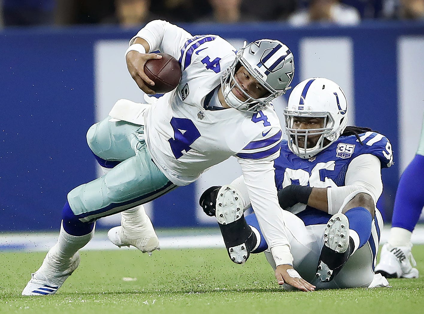 Indianapolis Colts defensive tackle Denico Autry (96) sacks Dallas Cowboys quarterback Dak Prescott (4) in the second half of their game at Lucas Oil Stadium on Sunday, Dec. 16, 2018. The Colts shut-out the Cowboys 23-0.