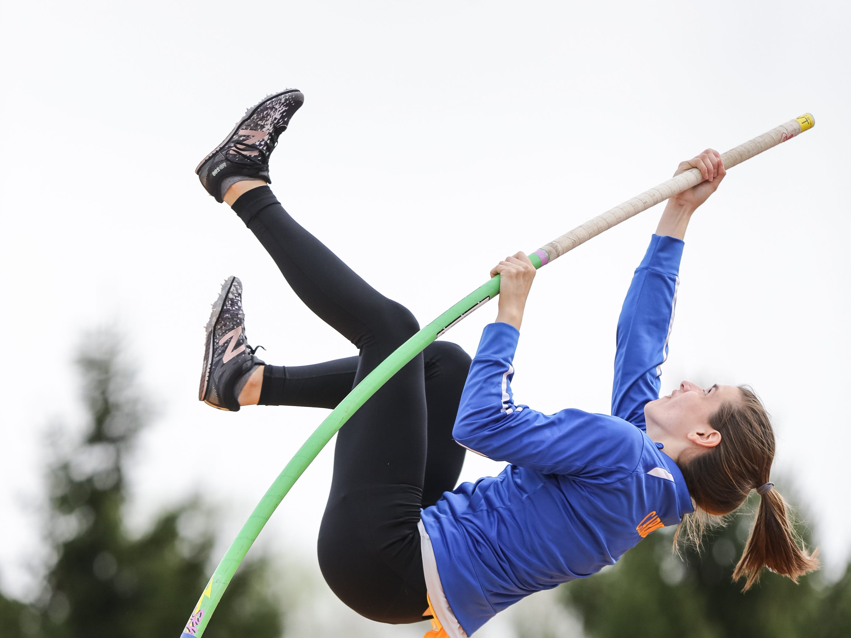 Carmel High School pole vaulter, Kara Deady takes a warm up vault before a track meet at C.H.S. in Ind. on Friday, May 4, 2018. Mark Deady competed in the 1500 meter race during the 1988 Olympic Games in Soul South Korea while Kara's mother, Dawn Gelon earned the sixth-best Heptathlon score in Indiana University history.