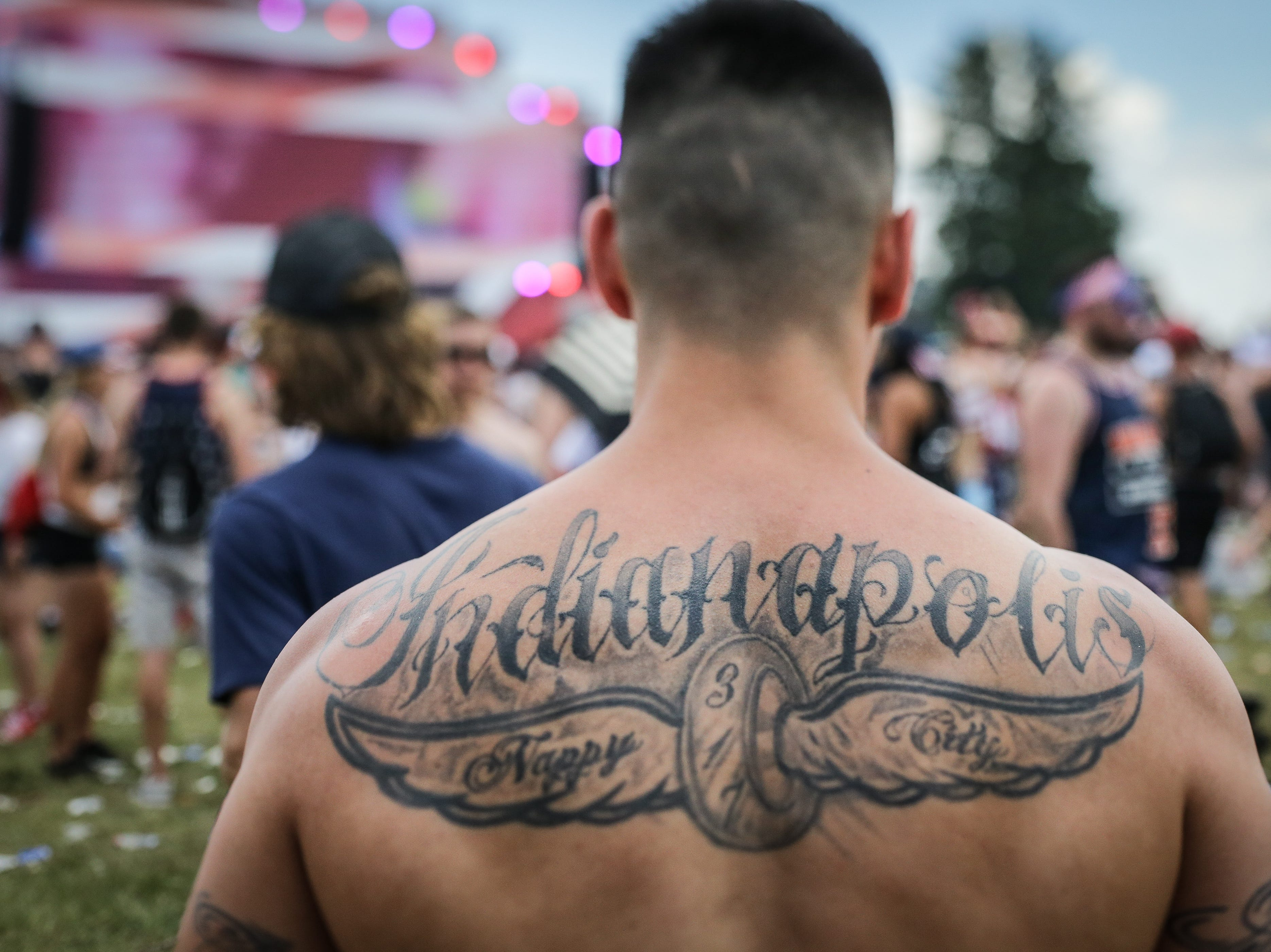 John Ellett shows off his 'Indianapolis Nappy City, 317' tattoo in the Snake Pit during the 102nd running of the Indy 500 at Indianapolis Motor Speedway on Sunday, May 27, 2018.