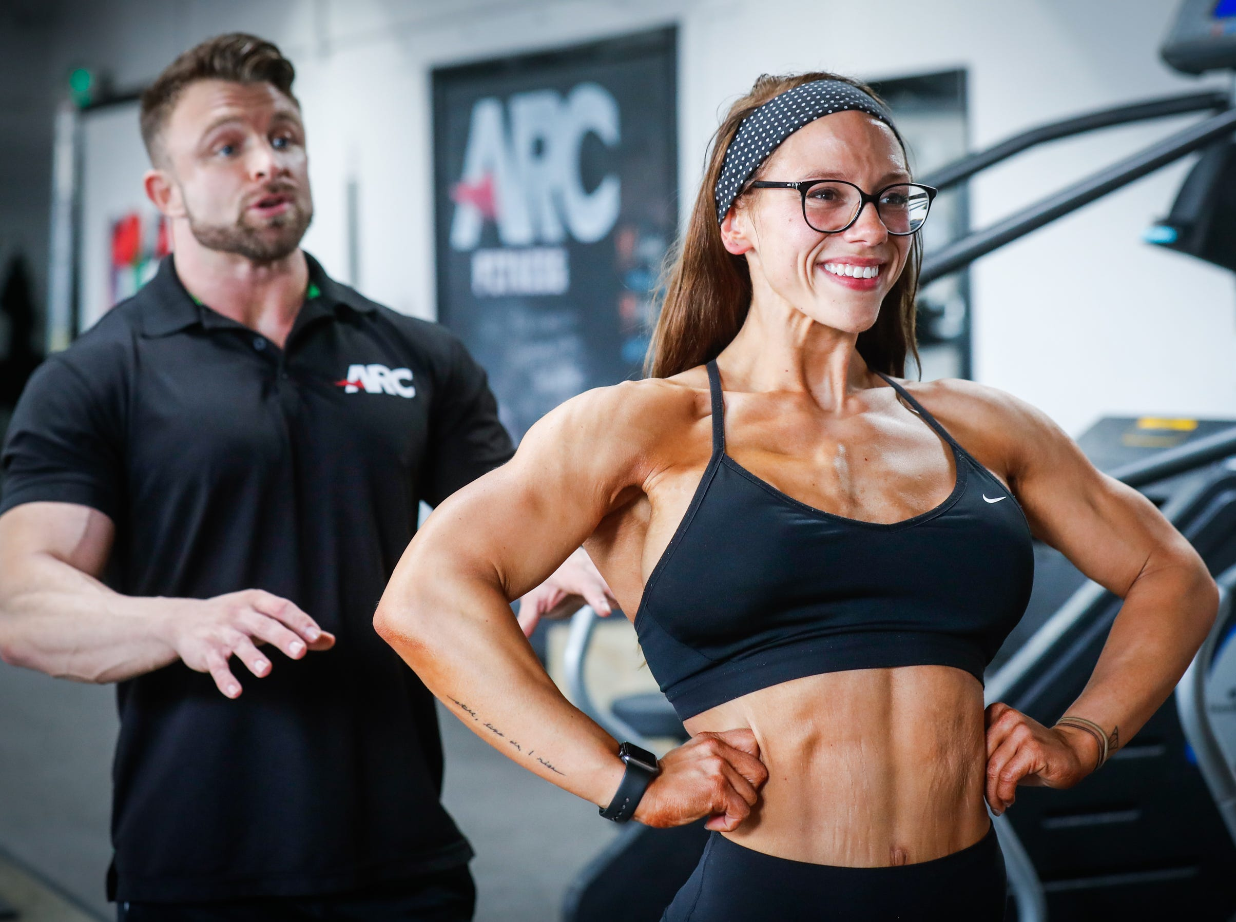 Rachael Heffner practices a Wonder Woman bodybuilding pose under the supervision of Personal Trainer and Body Building Coach Adam Cayce at ARC Fitness Indy on Tuesday, Aug. 21, 2018. Heffner went from weighing 300 pounds in 2011 to becoming the 2018 NPC Indiana State Championships Women's Open Physique Overall Champion.