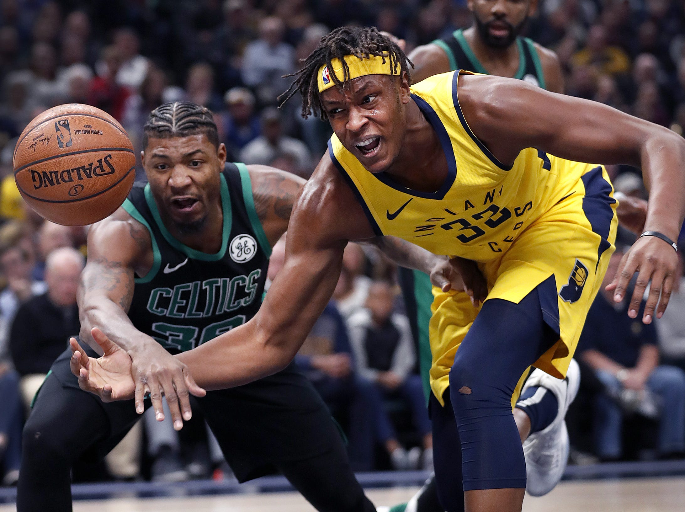 Indiana Pacers center Myles Turner (33) is fouled by Boston Celtics guard Marcus Smart (36) in the first half of their game at Bankers Life Fieldhouse on Nov 3, 2018.