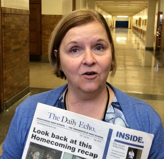 Shortridge High School's student media teacher, Donna Griffin holds the first edition of the The Daily Echo.
