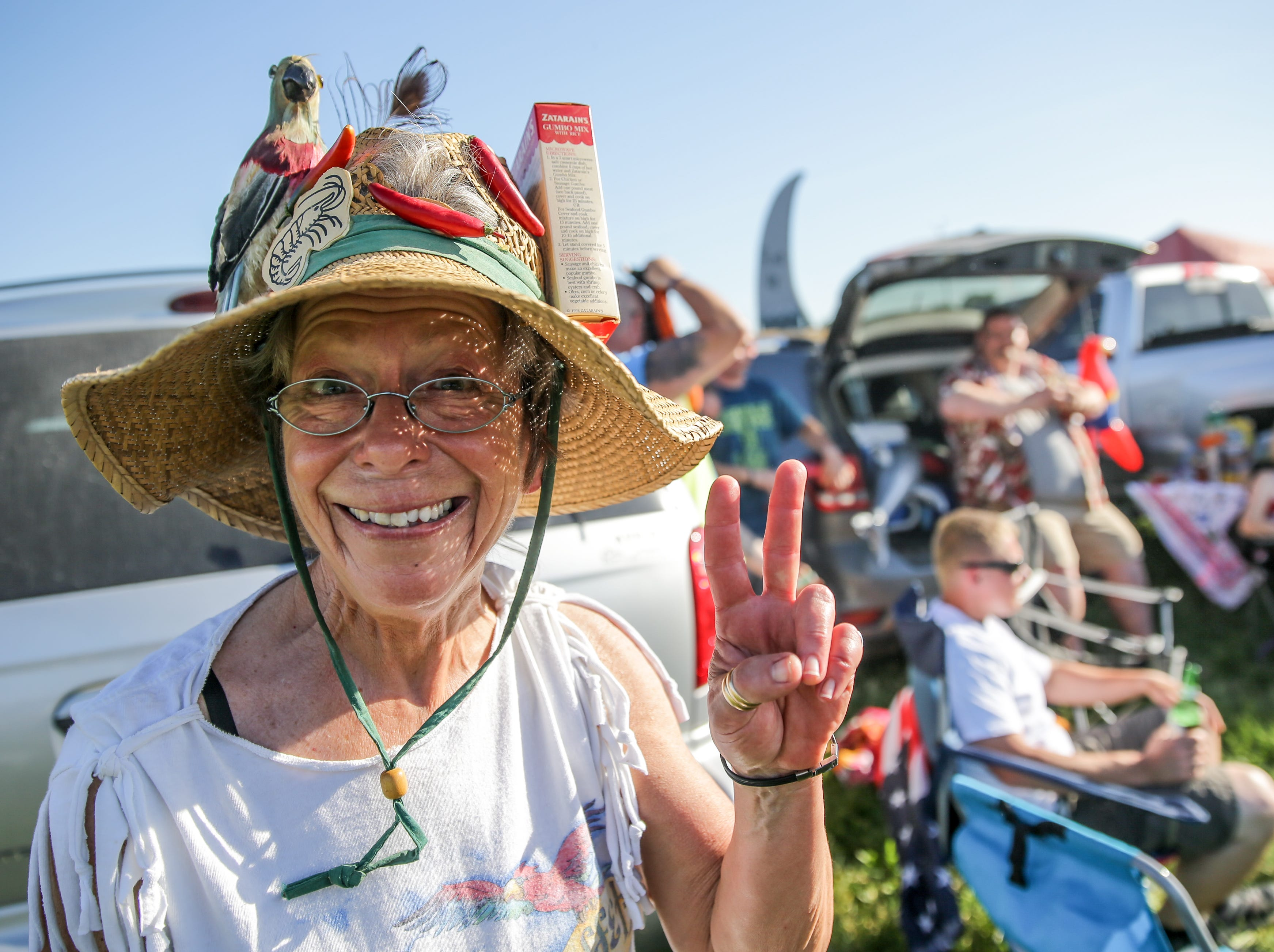 Amy Vandergrift tailgates before the Jimmy Buffett and the Coral Reefer Band performance at Ruoff Home Mortgage Music Center in Noblesville Ind. on Thursday, May 24, 2018.