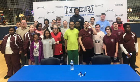 Myles Turner poses for a photo with Special Olympics athletes at Incrediplex Monday night.