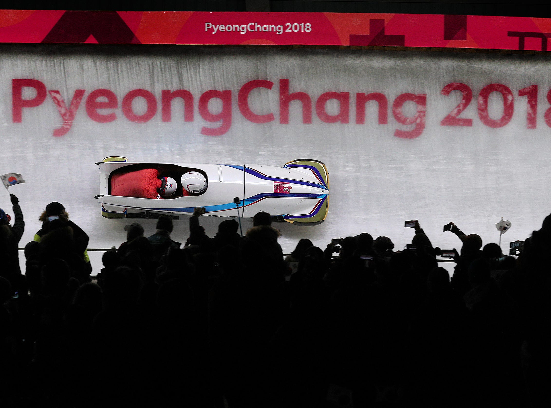 Feb 19, 2018; Pyeongchang, South Korea; Republic of Korea's Won Yunjong and Seo Youngwoo fly through turn 14 during the 2-Man Bobsleigh finals at the Pyeongchang 2018 Olympic Winter Games at Olympic Sliding Centre. Mandatory Credit: Matt Kryger-USA TODAY Sports