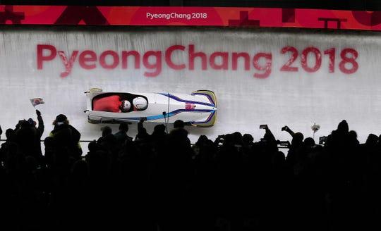 Feb 19, 2018; Pyeongchang, South Korea; Republic of Korea's Won Yunjong and Seo Youngwoo fly through turn 14 during the 2-Man Bobsleigh finals at the Pyeongchang 2018 Olympic Winter Games at Olympic Sliding Centre. Mandatory Credit: Matt Kryger-USA TODAY Sports