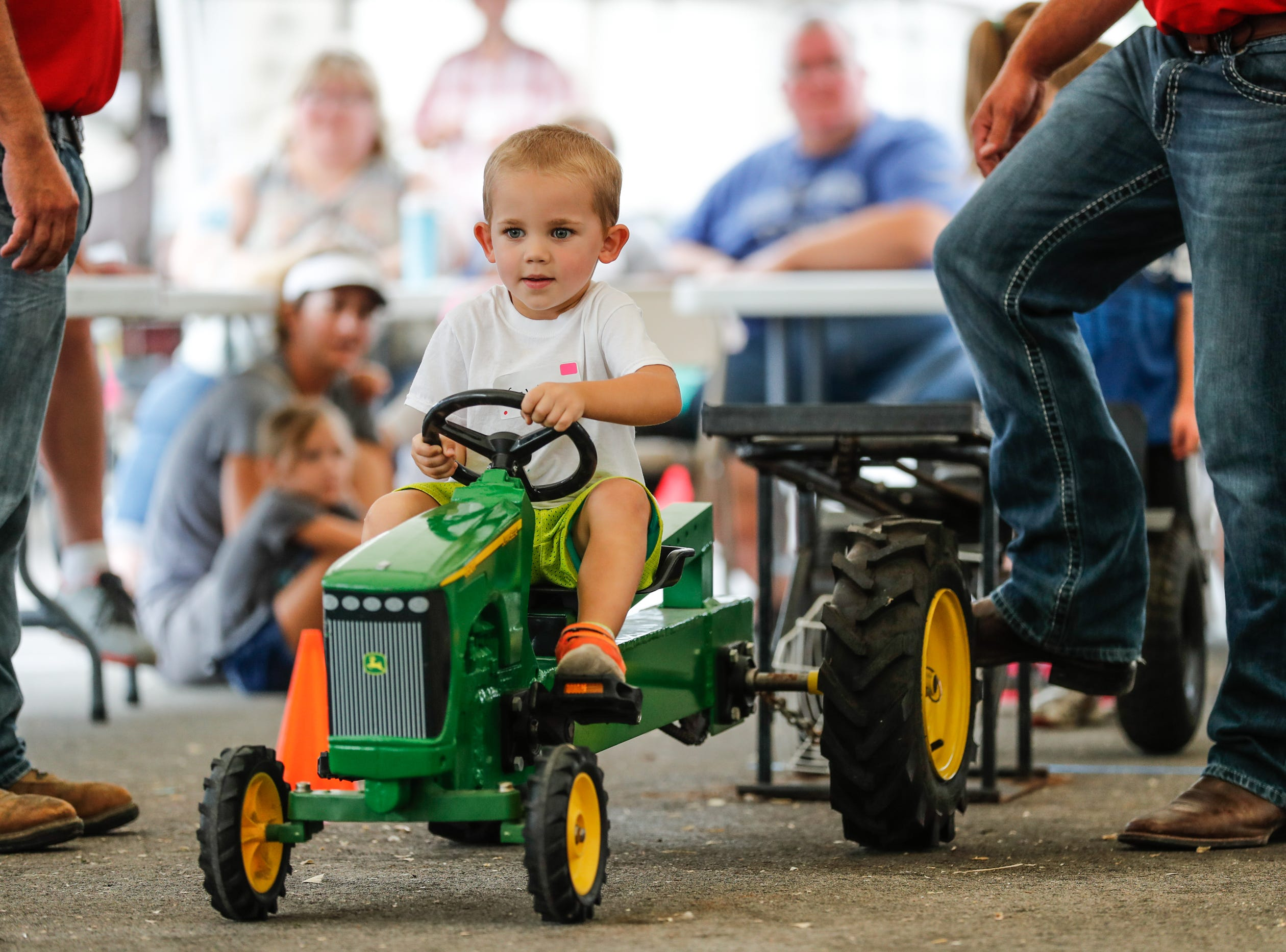 Caleb Lehman competes in the youth pedal tractor pull during the Hamilton County Fair, held at the Hamilton County 4-H Fairgrounds on Sunday, July 22, 2018.