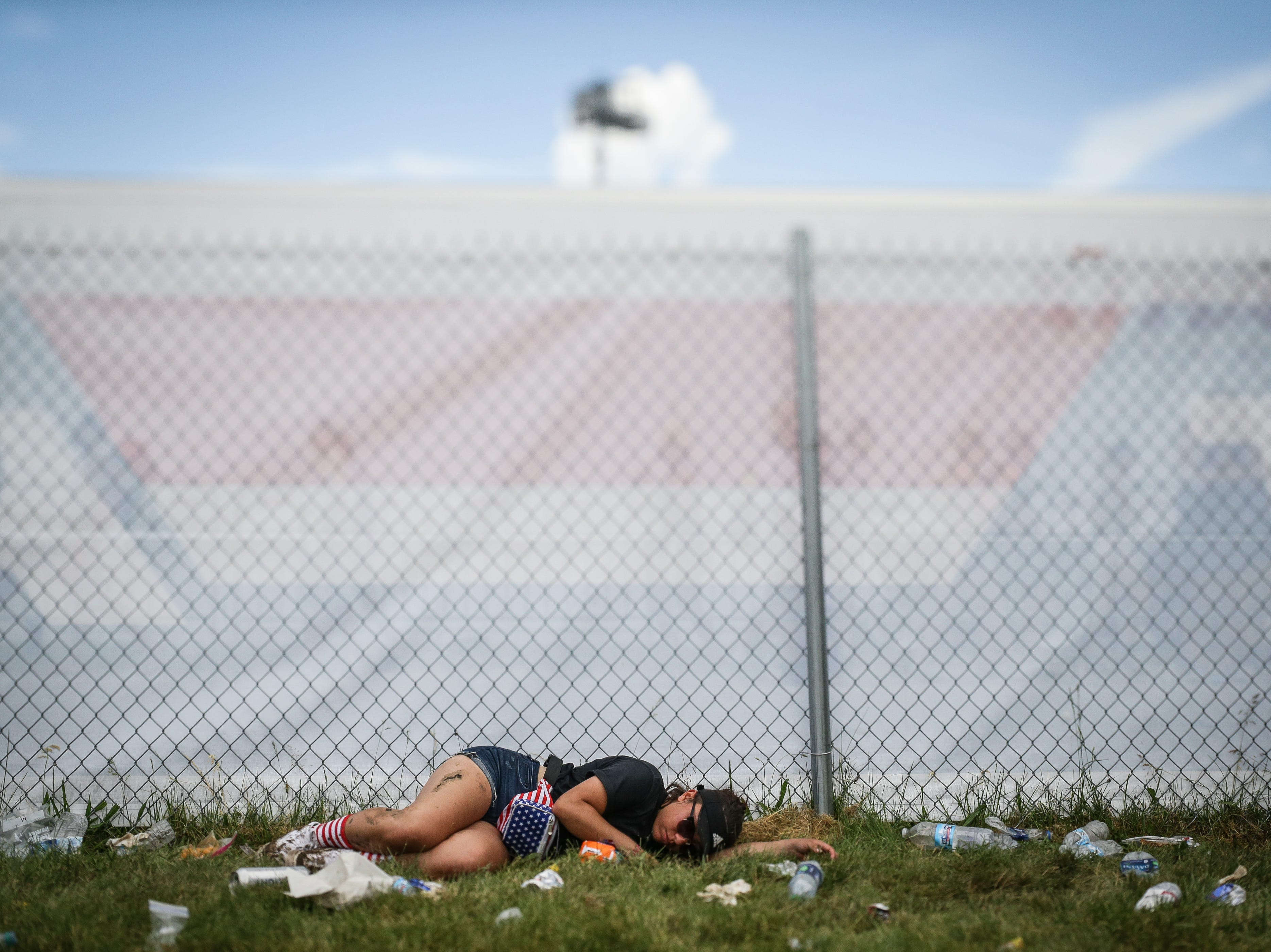 A fan lays down in the Snake Pit during the 102nd running of the Indy 500 at Indianapolis Motor Speedway on Sunday, May 27, 2018.
