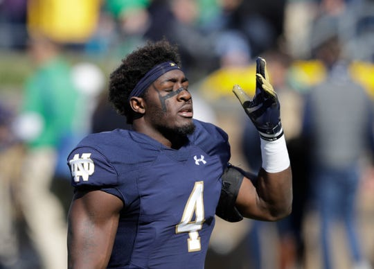 Notre Dame linebacker Te'von Coney (4) prepares for an NCAA college football game against Pittsburgh,, Oct. 13, 2018, in South Bend, Ind.
