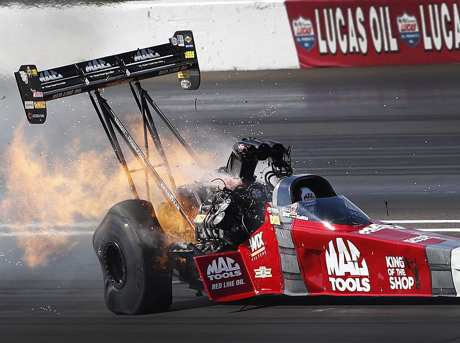 Top Fuel driver Doug Kalitta hangs onto his car as his engine blows during his first run of the day during the NHRA U.S. Nationals at Lucas Oil Raceway on Monday, Sept. 3, 2018.