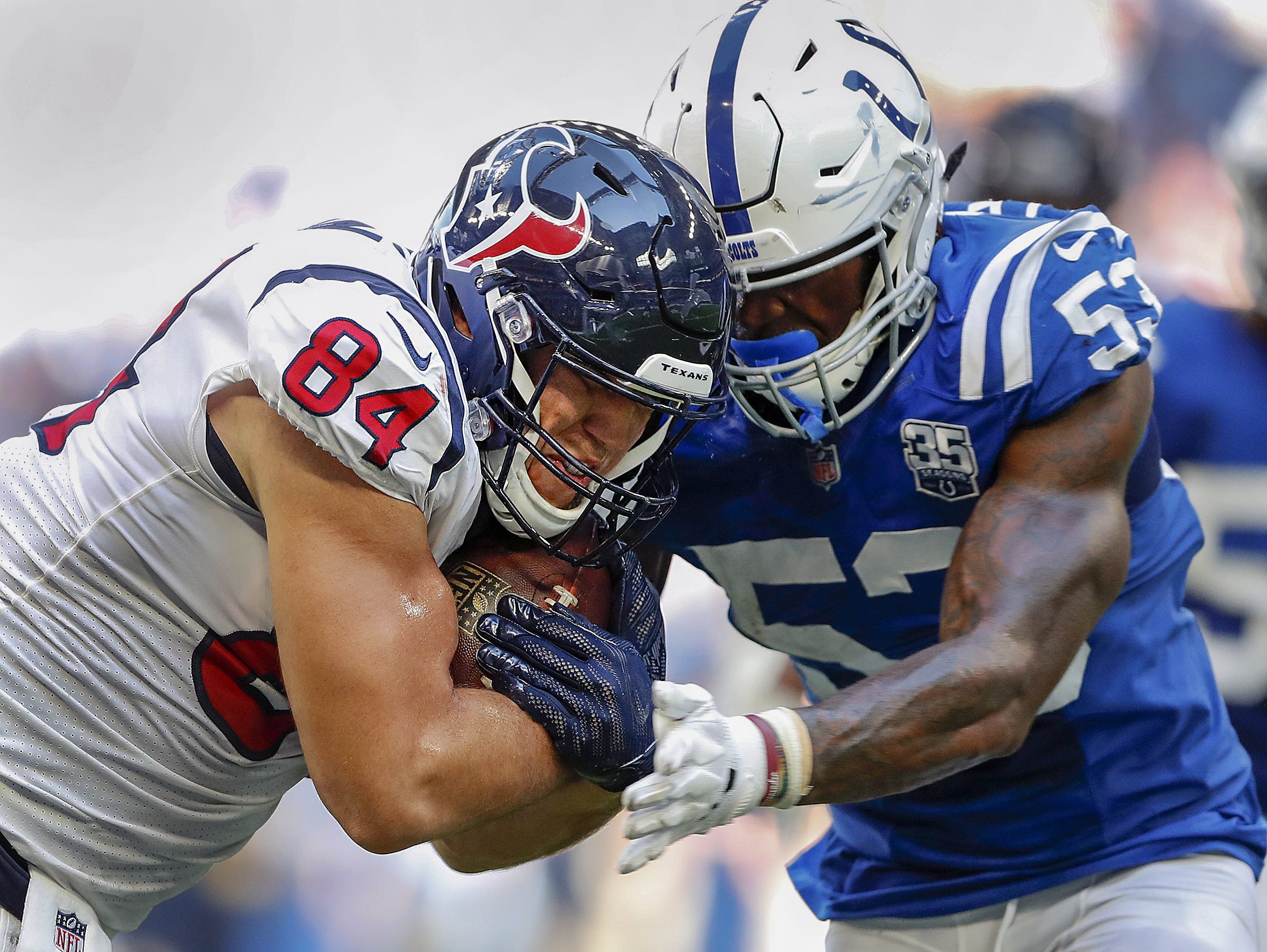 Indianapolis Colts linebacker Darius Leonard (53) hits Houston Texans tight end Ryan Griffin (84) in the second half of their game on Sunday, Sept. 30, 2018. The Indianapolis Colts lost 37-34 in overtime to the Houston Texans.