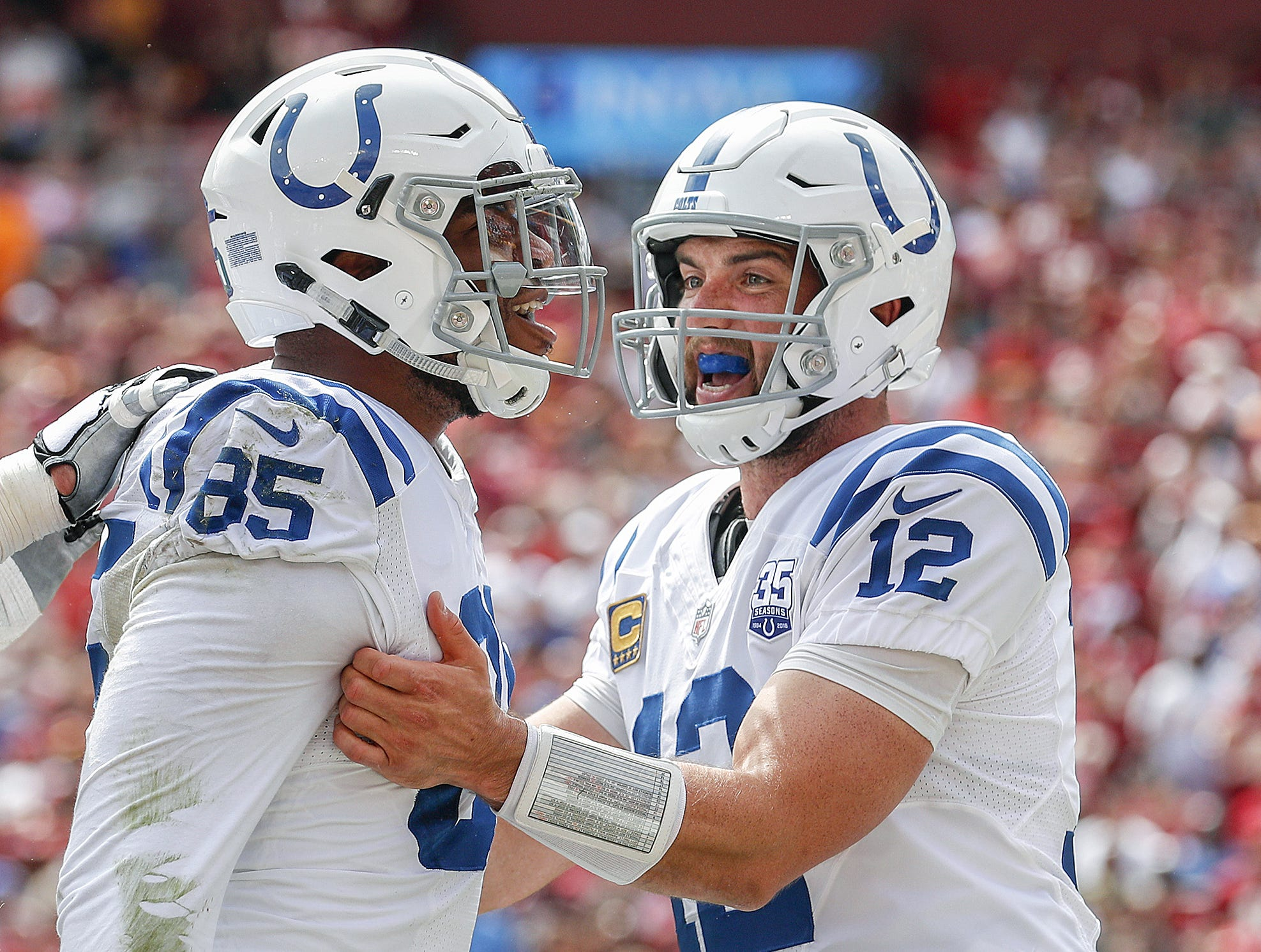 Indianapolis Colts tight end Eric Ebron (85) and quarterback Andrew Luck (12) react to scoring on the team's opening possession of the game. The Indianapolis Colts play the Washington Redskins at FedEx Field in Landover, MD., Sunday, Sept. 16, 2018.