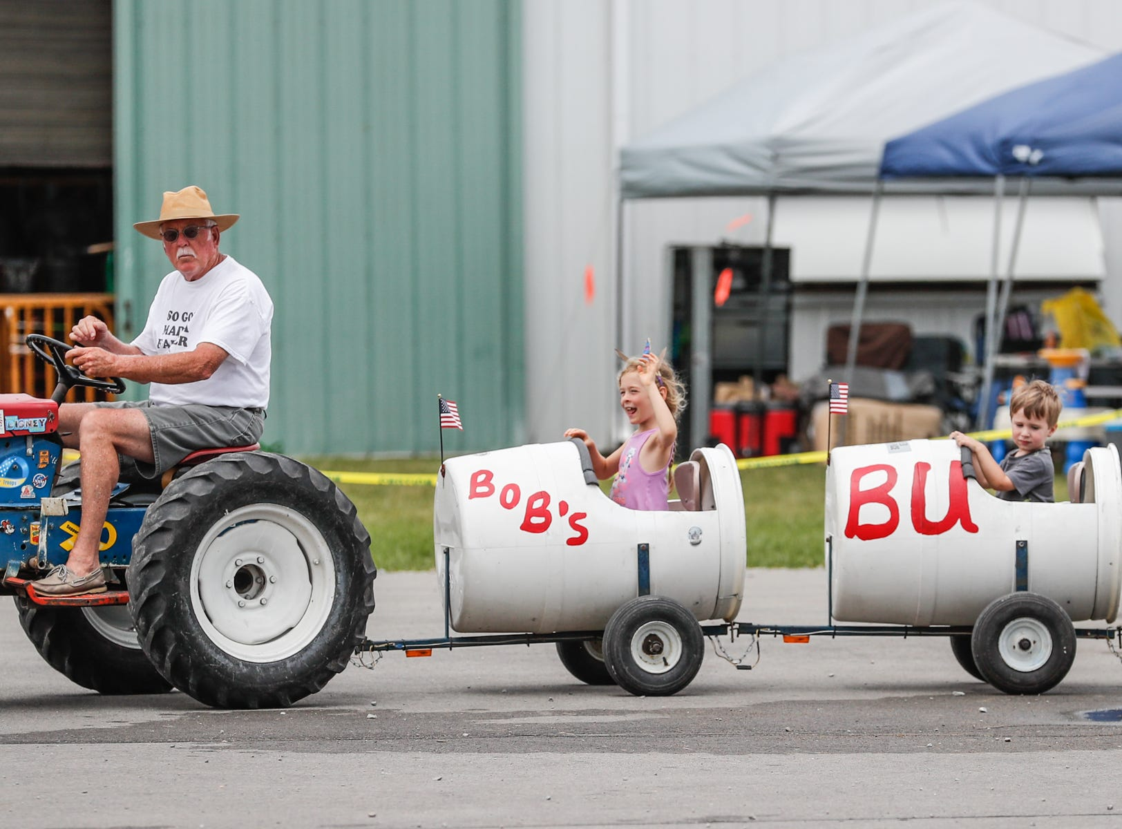 Kids take a spin on Bobs Bumpy Barrel Ride during the Hamilton County Fair, held at the Hamilton County 4-H Fairgrounds on Sunday, July 22, 2018.