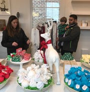 Jordan Blocker of Madison, left, and her husband, Anthony Blocker, and their son, Grayson, age 2, look around the Musee shop at the Town of Livingston.