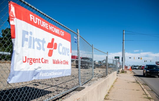 A sign for the under-construction First Care urgent care clinic is seen along East Main Street in Richmond, Ind., on  Oct. 11, 2018.