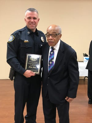 Jackson Police Chief Julian Wiser stands with former pastor Ronald M. Cunningham, the namesake of the Ronald M. Cunningham Award for Community Service, at the 148th Founders Celebration of the Jackson Christian Methodist Episcopal Church on Friday.