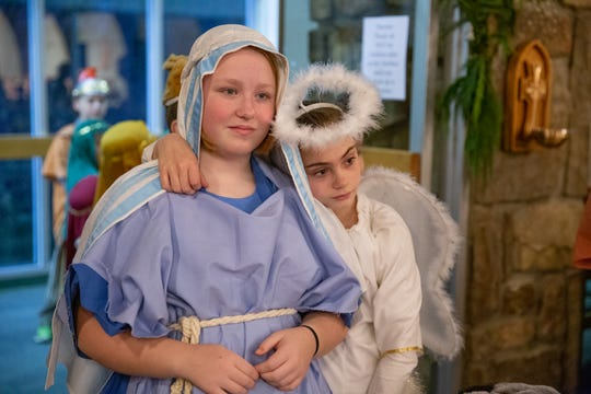 Taylor Bell, 10, right, leans on friend Janie Bales as they line up to begin the children's Nativity pageant at Episcopal Church of the Good Samaritan in Knoxville on Sunday, Dec. 16, 2018.