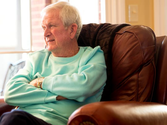 """Mike Dunn listens as his wife Sandy, not pictured, talks about his sister, Jean Nance. """"She was the backbone of our family, did everything for everybody,"""" he said."""